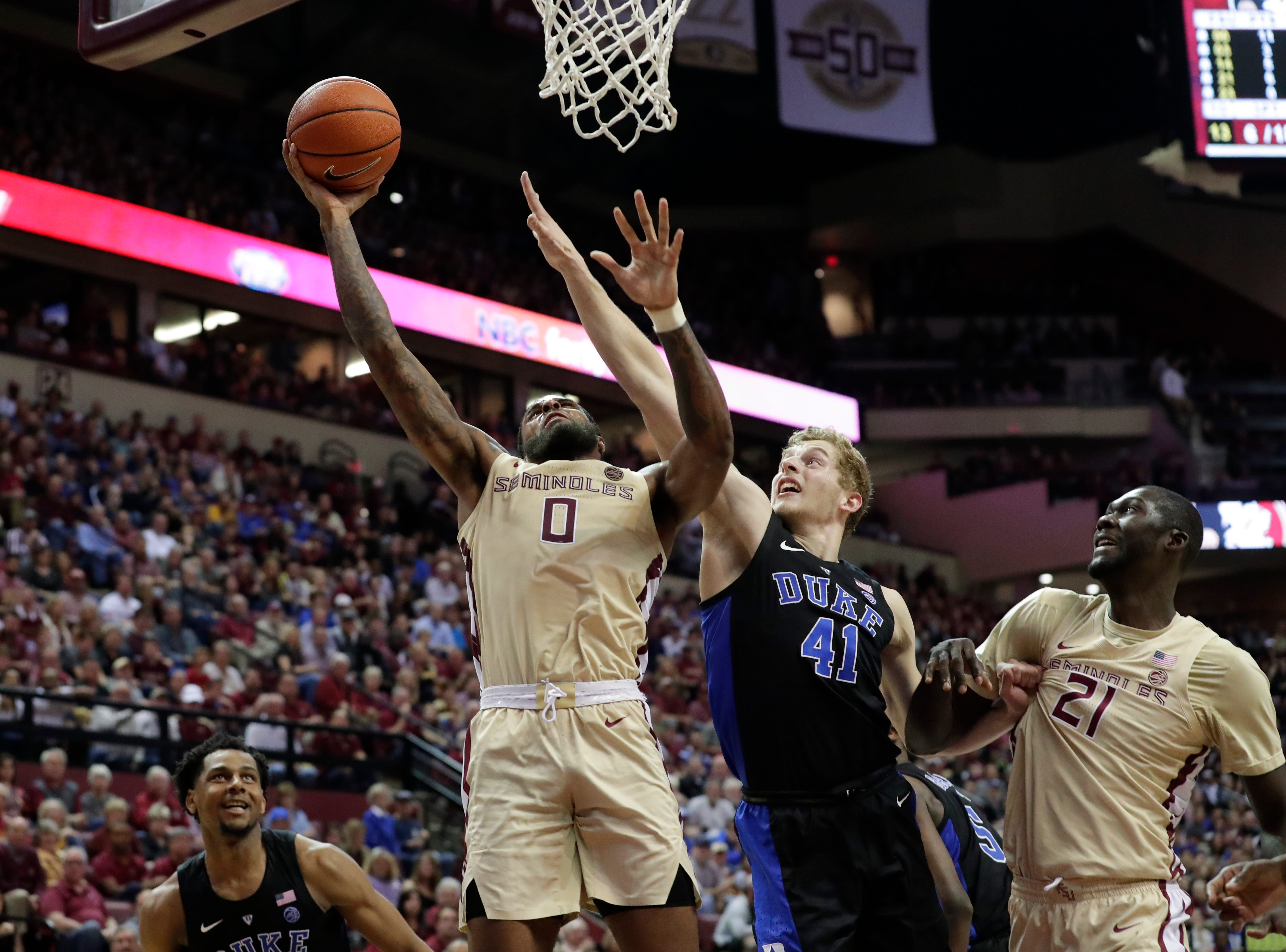 Florida State Seminoles forward Phil Cofer (0) goes in for a layup while Duke Blue Devils forward Jack White (41) reaches from behind to try to block the shot. Ranked 13 in the ACC, the Florida State Seminoles host the number 1 team, the Duke Blue Devils, at the Tucker Civic Center, Saturday, Jan. 12, 2019.