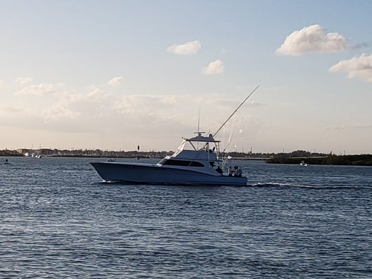 Anticipation returns to Pelican Yacht Club in Fort Pierce flying a Saturday-best five sailfish flags.