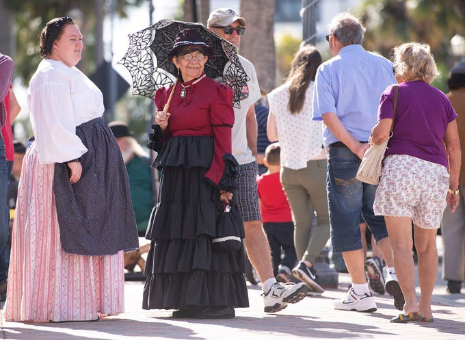 """Carolyn Dehart (left) and Mary Beaty (center), both of Fort Pierce, dress in Civil War period clothes as they participate in the third annual Treasure Coast History Festival on Saturday, Jan, 12, 2019 in downtown Fort Pierce. """"We just really enjoy doing it,"""" said Beaty about participating in the festival, where historical re-enactors depicted life on the Treasure Coast in the 1800s and early 1900s. """"It's important to know your history."""""""