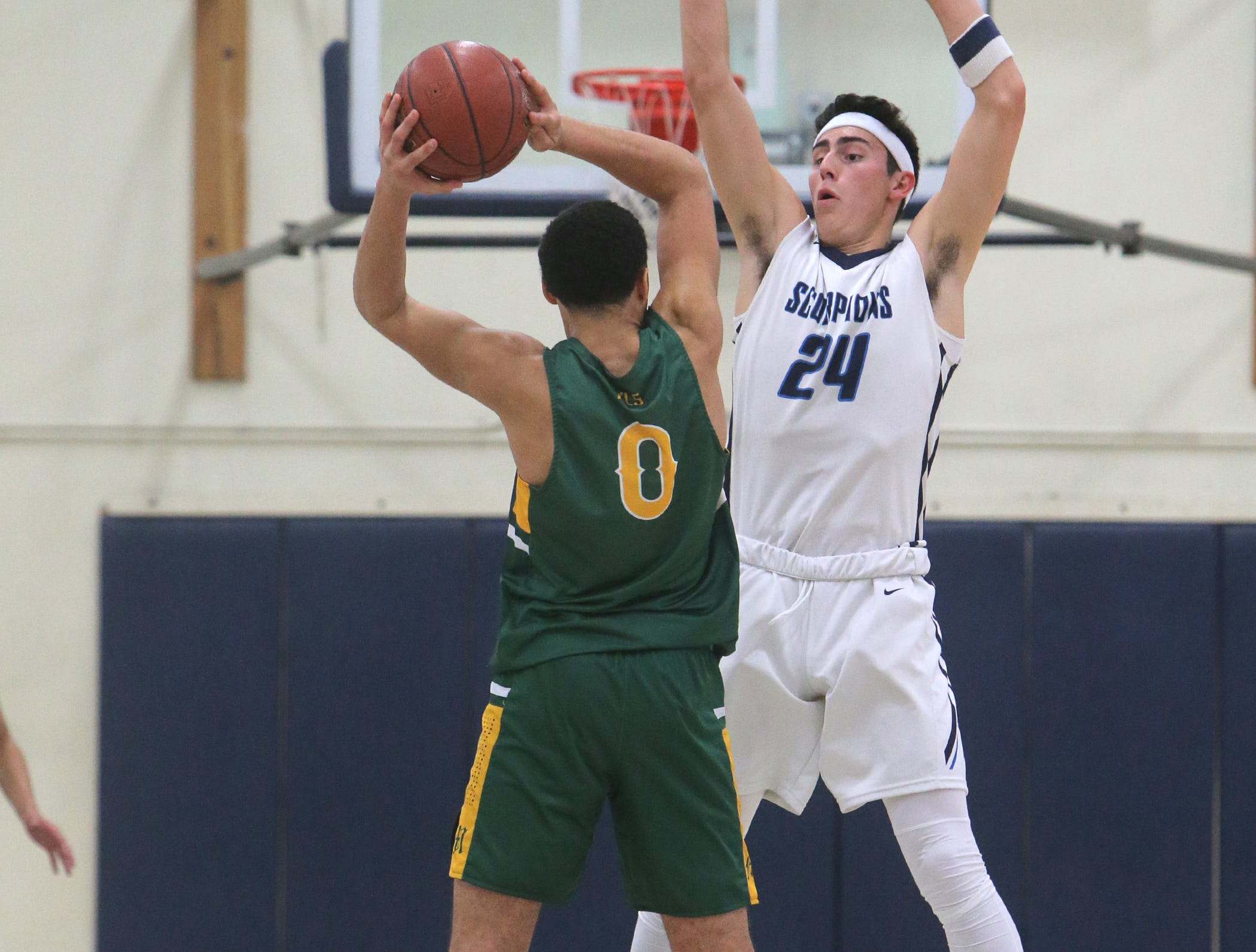Moorpark's Drake London is defended by Camarillo's Jaime Jaquez Jr. during Friday night's Coastal Canyon League game at Camarillo. The USC-bound London and the UCLA-bound Jaquez each had 34 points in the Camarillo's 82-68 victory.