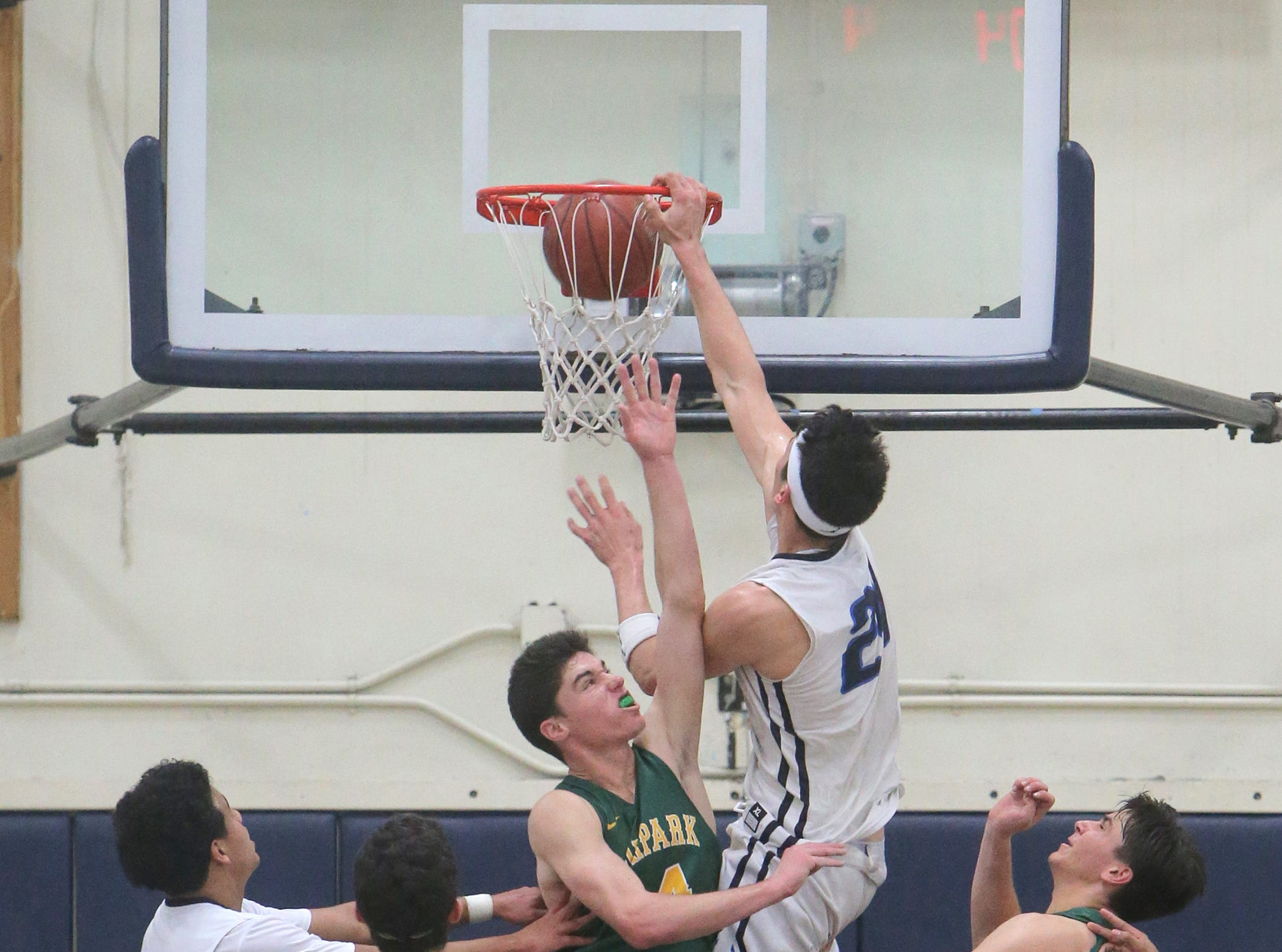 Camarillo star Jaime Jaquez Jr. throws one down over Moorpark's Troy Anderson during Friday night's Coastal Canyon League game at Camarillo High. Jaquez scored 34 points in the Scorpions' 82-68 victory.