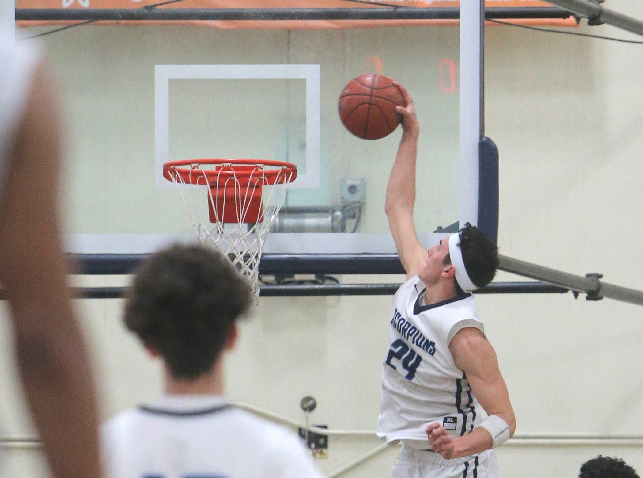 Jaime Jaquez Jr. soars for a slam during Camarillo's 82-68 victory over Moorpark in a Coastal Canyon League showdown Friday night at Camarillo High. Jaquez finished with 34 points.
