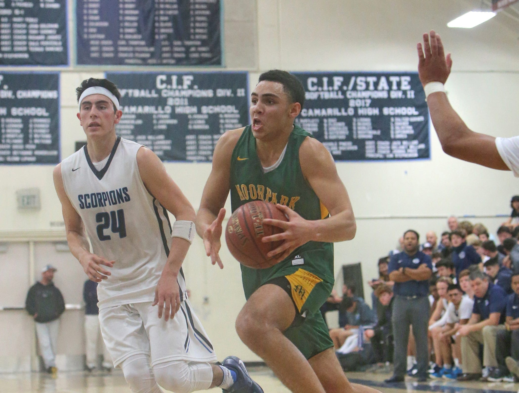 Moorpark's Drake London drives to the basket during Friday night's game against Camarillo. Drake scored 34 points in the Musketeers' 82-68 loss.