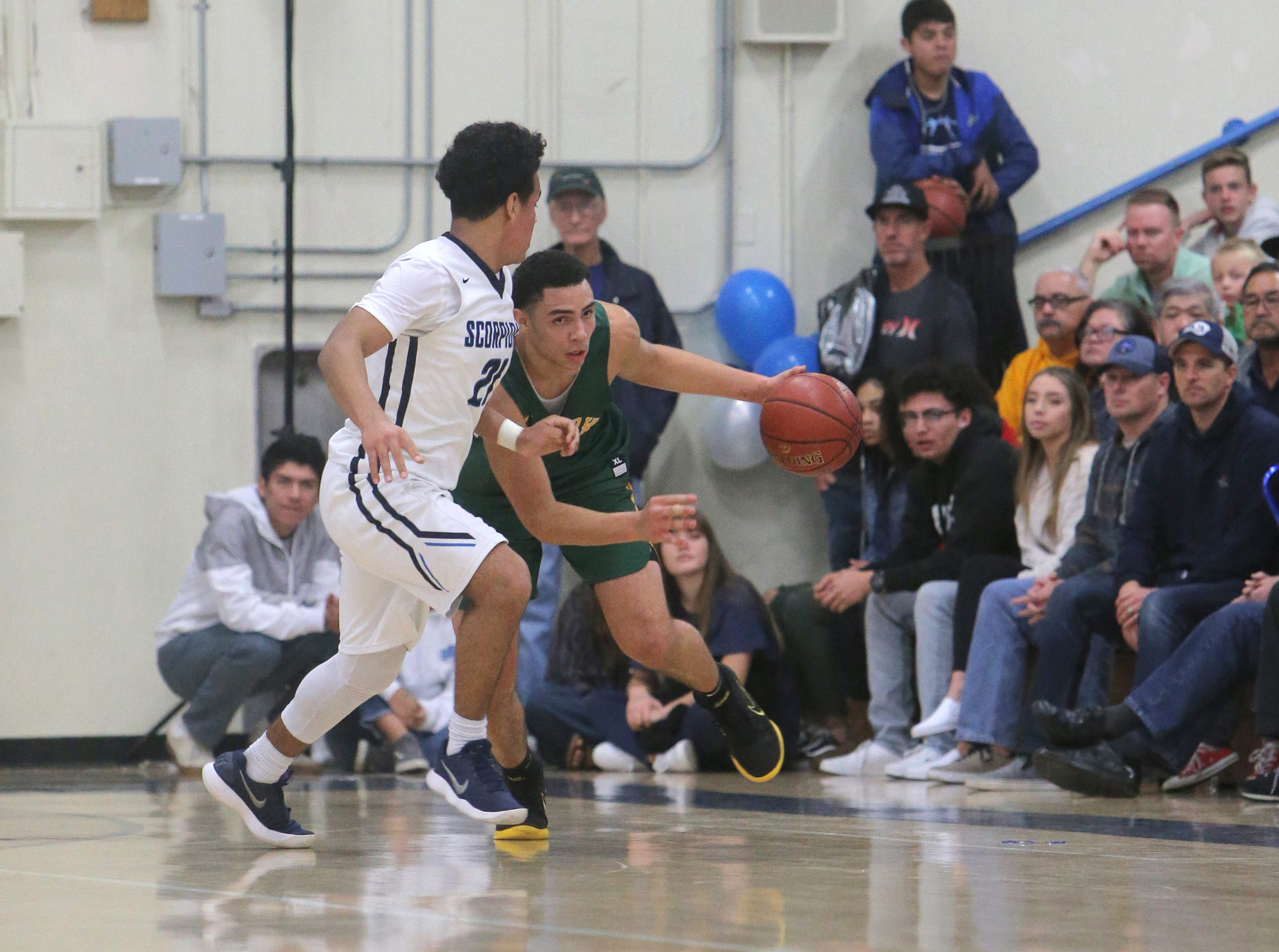Moorpark's Drake London is closely guarded by Camarillo's Carter Alexander during Friday night's Coastal Canyon League game at Camarillo High. London scored 34 points in a 82-68 loss.