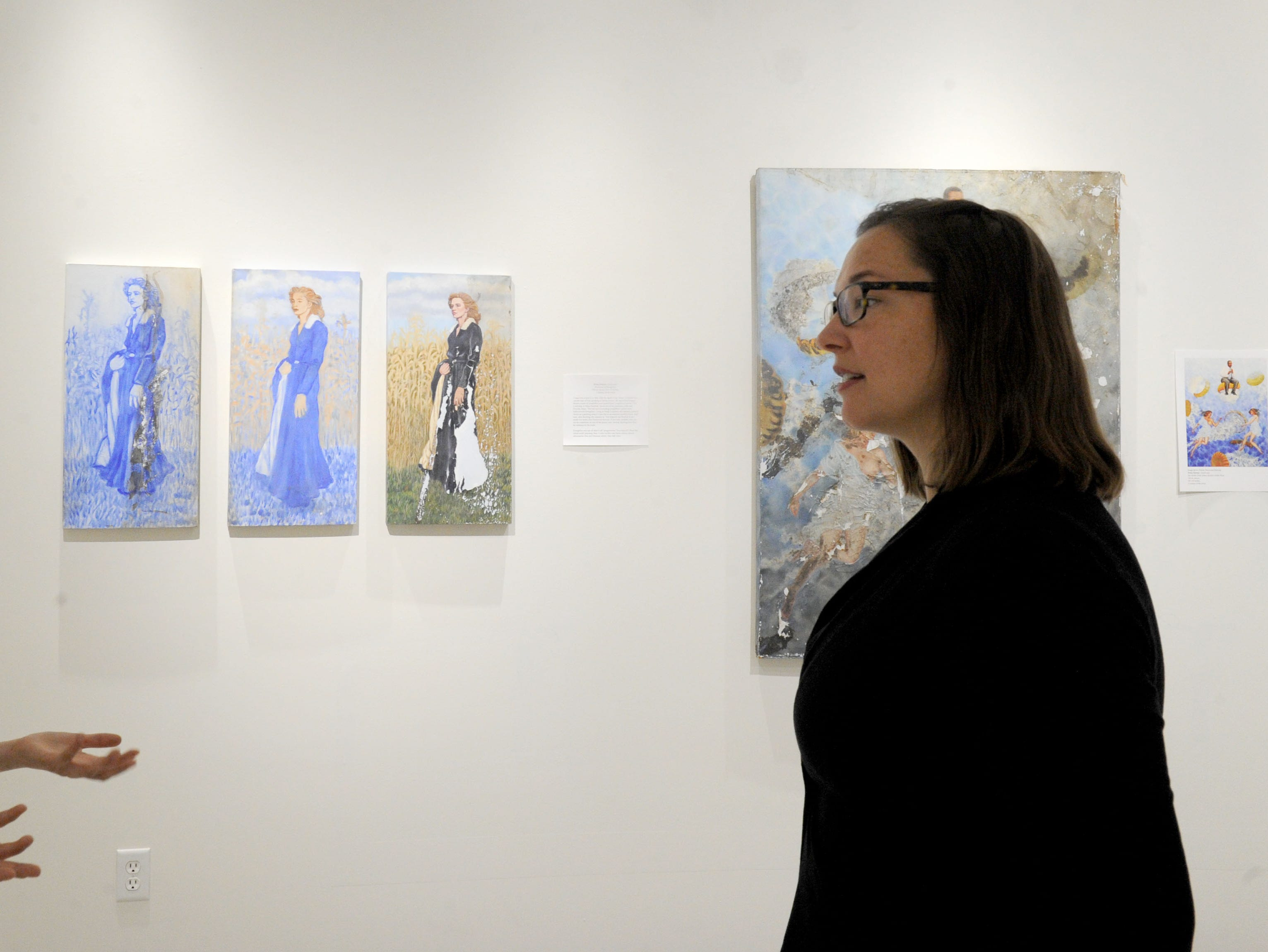 """Rachel Schmid (left), curator of the William Rolland Gallery of Fine Art, and  Katherine Hoffman, the John Stauffer professor of analytical chemistry, talk about the new exhibit, """"Traces: Revealing Secrets in Art and History."""" Hoffman will be use the paintings in """"Chemical Investigations of Art"""" class during the spring semester at California Lutheran University."""