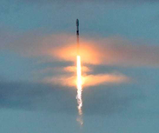A SpaceX Falcon 9 rocket carrying 10 Iridium Communications satellites blasts off through clouds over Vandenberg Air Force Base near Lompoc on Friday morning,.