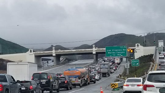 A view of southbound Highway 101 at the Lost Hills Road exit in Calabasas midday Saturday. The highway was closed in both directions as authorities apprehended the armed subject of a pursuit that began in Ventura County.