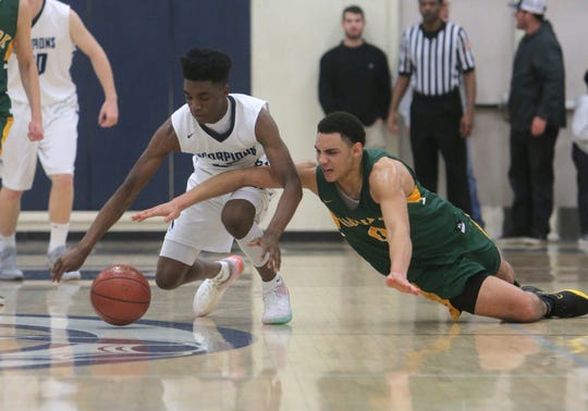 Moorpark's Drake London, right, and Camarillo's Landreau Tate Jr. go for a loose ball in a Coastal Canyon League game this season. The Scorpions will compete in Division 2AA playoffs, likely as the top seed, while the Musketeers are headed for the Division 4AA bracket. Playoff pairings will be announced Sunday.