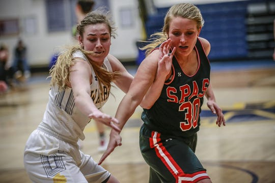 Wausau West's Kadie Deaton, left, and SPASH's Kaylee Hintz battle for position during the first half of Friday's Wisconsin Valley Conference girls basketball game.