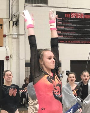 Marshfield junior Gracie Holland lands after her performance in the uneven bars during a Great Northern Conference-Large Division dual meet with SPASH on Thursday. Holland won the event with a score of 9.3