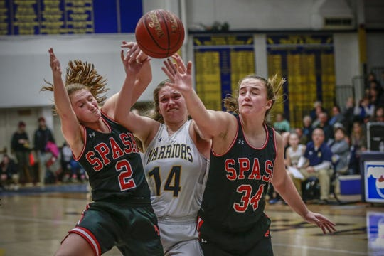 Wausau West's Anna Cunningham battle for the ball between SPASH's Rachel Lummis left, and Zoe Fink(34) during a Wisconsin Valley Conference girls basketball game on Friday at Wausau West High School