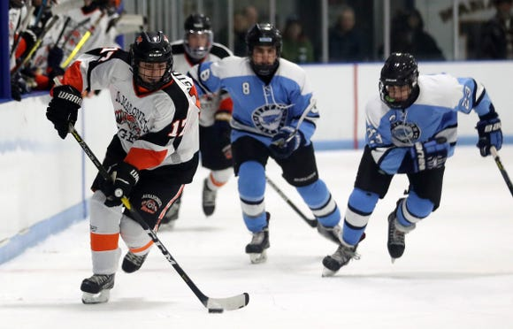 Mamaroneck's Alexander Astorina  (17) skates away from Suffern's Max Werfel (8) and Ryan Fennell (23) during hockey action at Hommocks Park Ice Rick in Mamaroneck Jan. 11, 2019. The two teams played to a 2-2 tie.