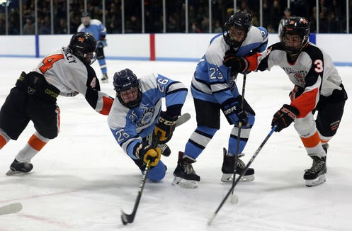 Suffern's Ryan Schelling (26) is hit by Mamaroneck's Thomas Conley (4) as he tries to get a shot off during hockey action at Hommocks Park Ice Rick in Mamaroneck Jan. 11, 2019. The two teams played to a 2-2 tie.