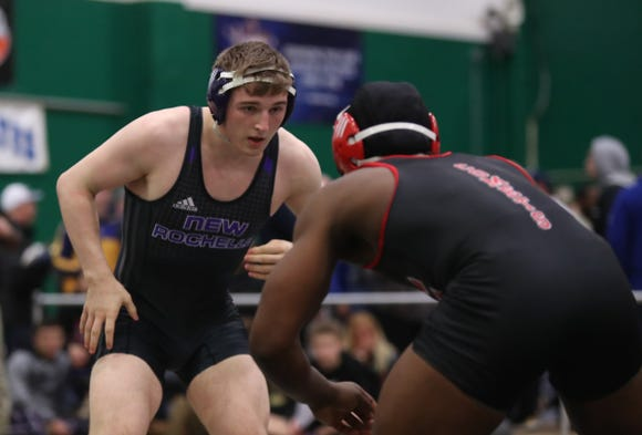 New Rochelle's Jake Logan pins Fombo Azah of Carthage in the finals of the 182-pound match at the Eastern States Wrestling Tournament at Sullivan County Community College in Loch Sheldrake on Saturday, January 12, 2019.
