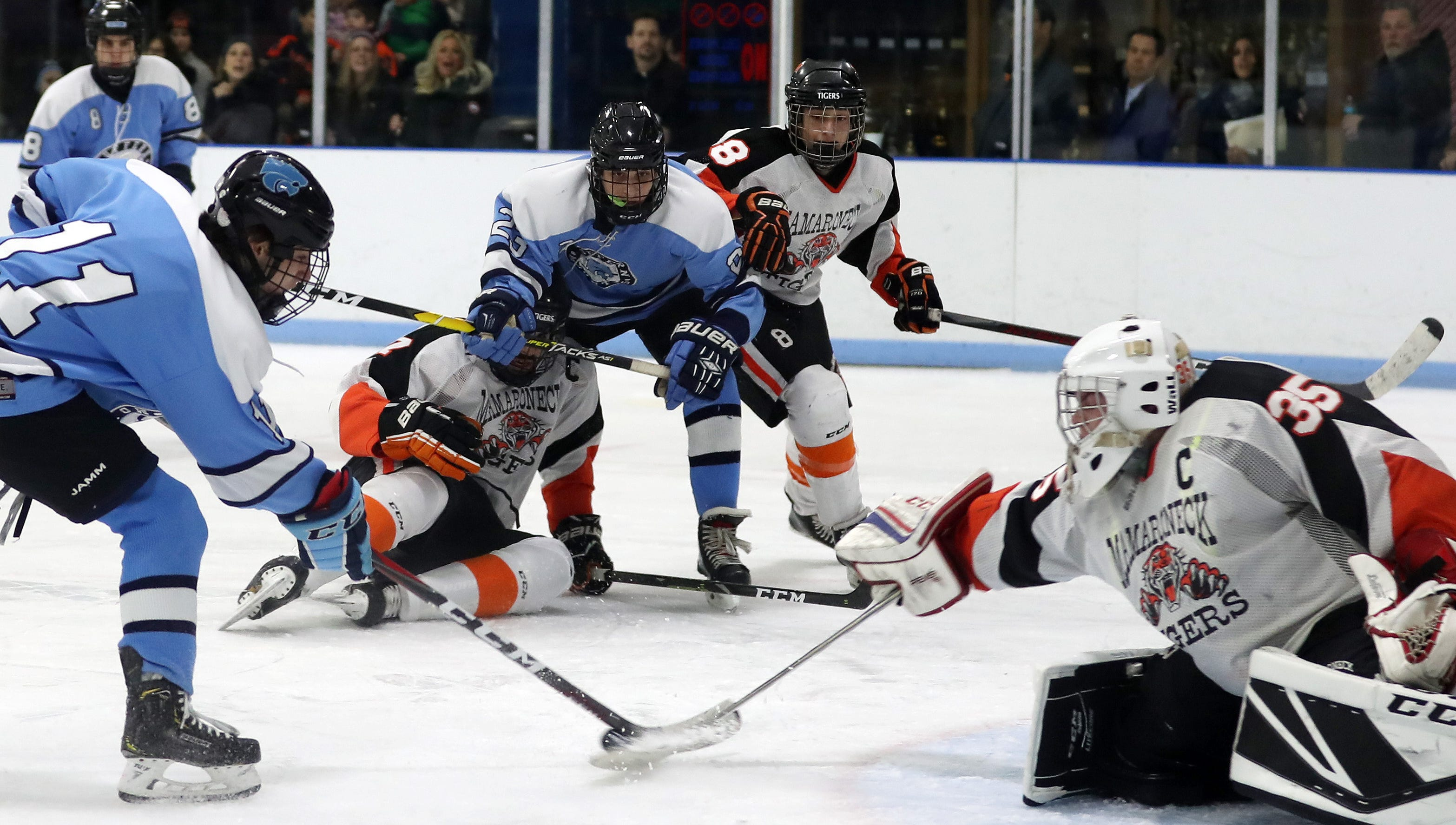 Mamaroneck goalie Jack Fried (35) stops a shot by Suffern's Tom McCarren (11)  during hockey action at Hommocks Park Ice Rink in Mamaroneck Jan. 11, 2019. The two teams played to a 2-2 tie.