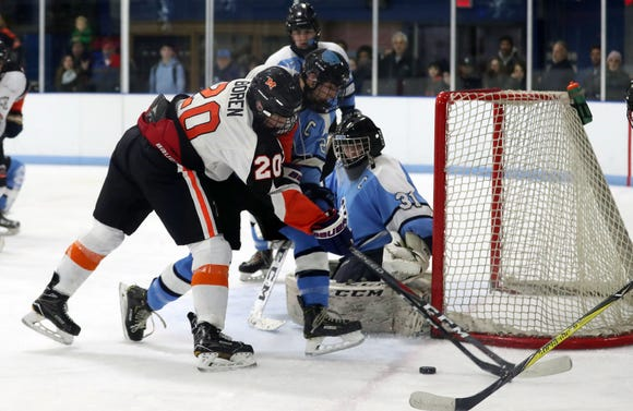 Mamaroneck's Benjamin Boren (2) has his path to the goal blocked by Suffern's  Kyle Foresta (21) during hockey action at Hommocks Park Ice Rick in Mamaroneck Jan. 11, 2019. The two teams played to a 2-2 tie.