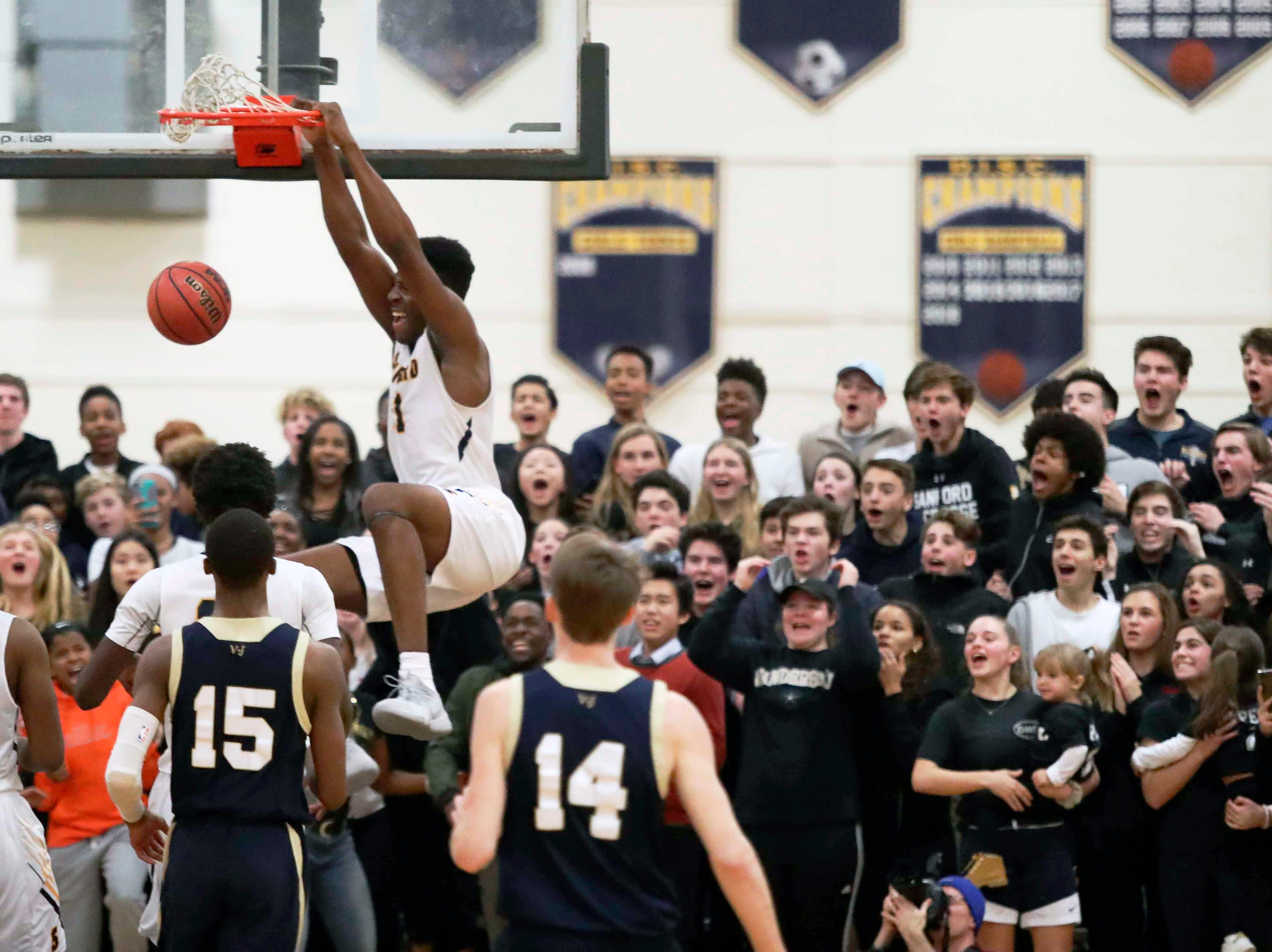 Sanford's Nnanna Njoku throws down a dunk during the Warriors' 65-47 win at home Friday.
