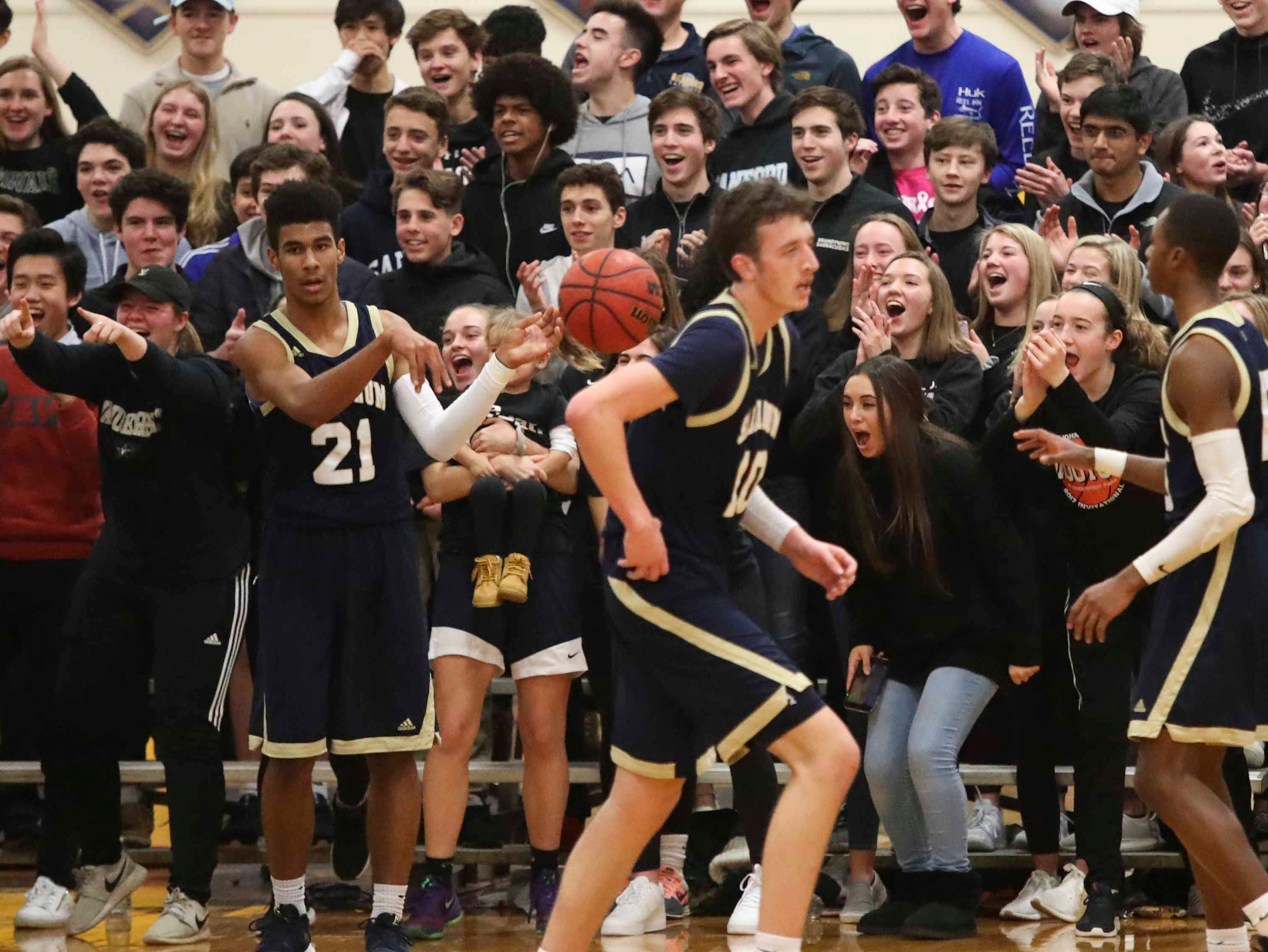 The Sanford students enjoy one of many slams by the home team during the Warriors' 65-47 win Friday.