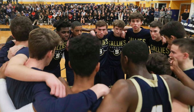 The Sals get set before the Warriors' 65-47 win at home Friday.