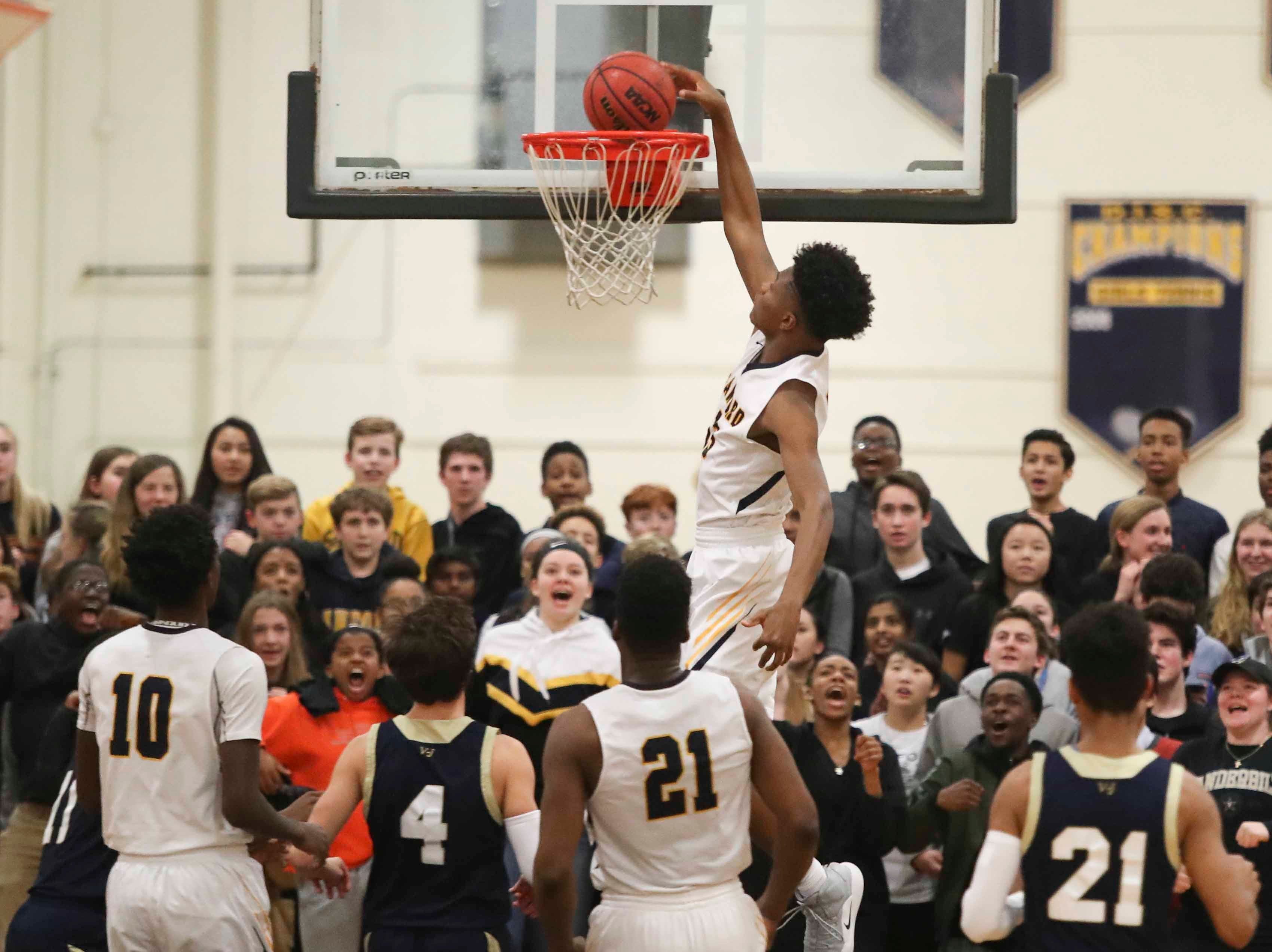 Sanford's Jyare Davis slams during the first quarter of the Warriors' 65-47 win against Salesianum at home Friday.