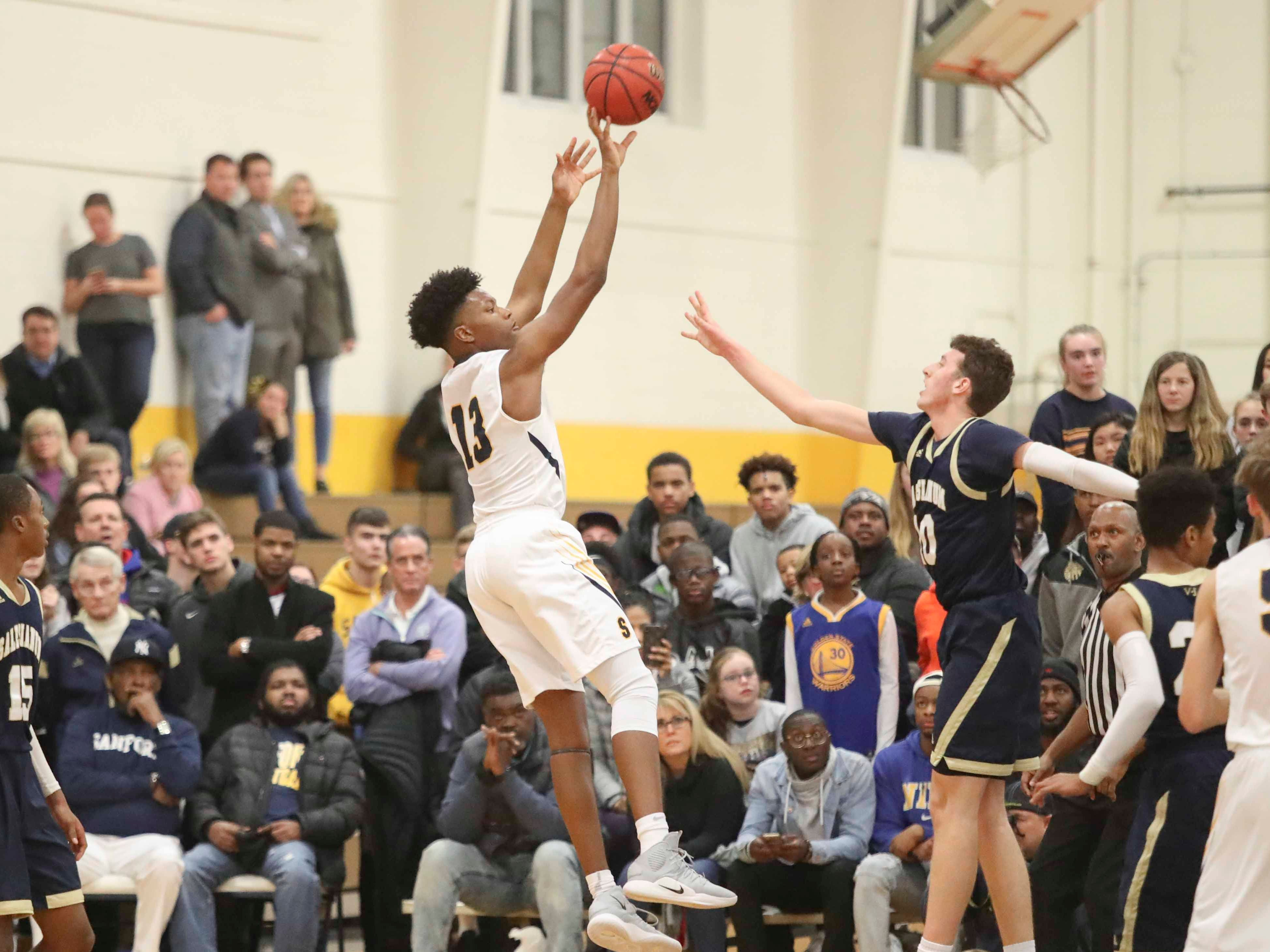 Sanford's Jyare Davis shoots over Salesianum's Jack Brown during the Warriors' 65-47 win at home Friday.
