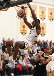 Sanford's Nnanna Njoku slams one home during the top-ranked Warriors' 65-47 home win over Salesianum on Friday night.