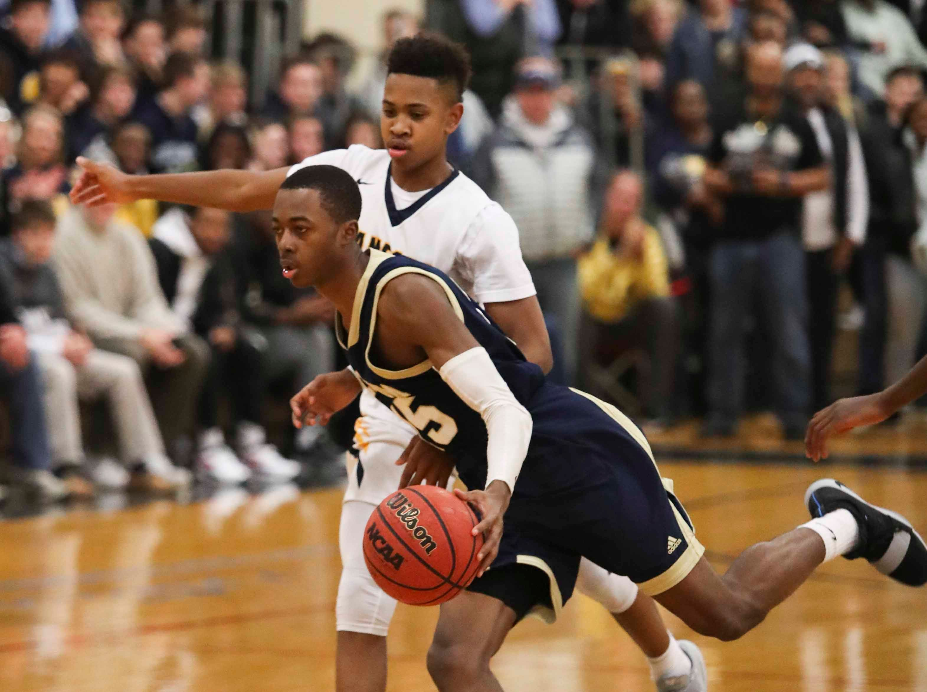 Salesianum's Rasheed Caulk (front) moves against Corey Perkins during the Warriors' 65-47 win at home Friday.