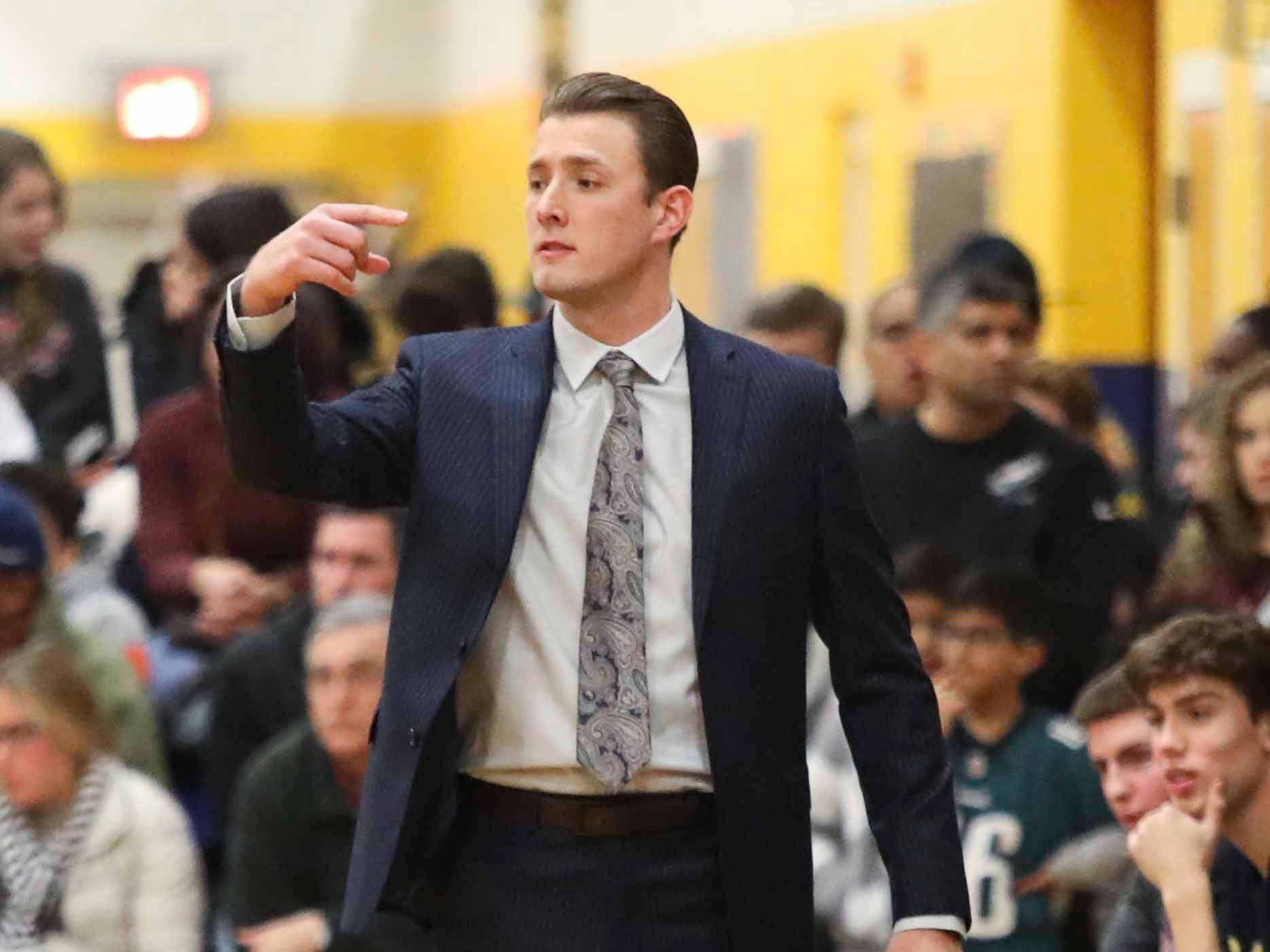 Salesianum head coach Taylor Trevisan directs his team in the second half of the Warriors' 65-47 win at home Friday.