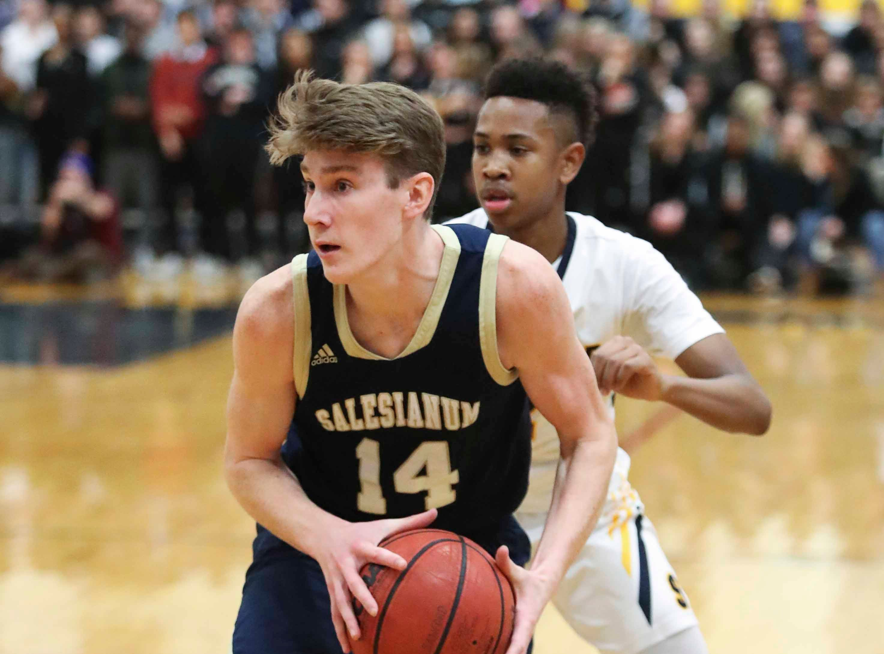Salesianum's Sean Regan works in front of Sanford's Corey Perkins during the Warriors' 65-47 win at home Friday.