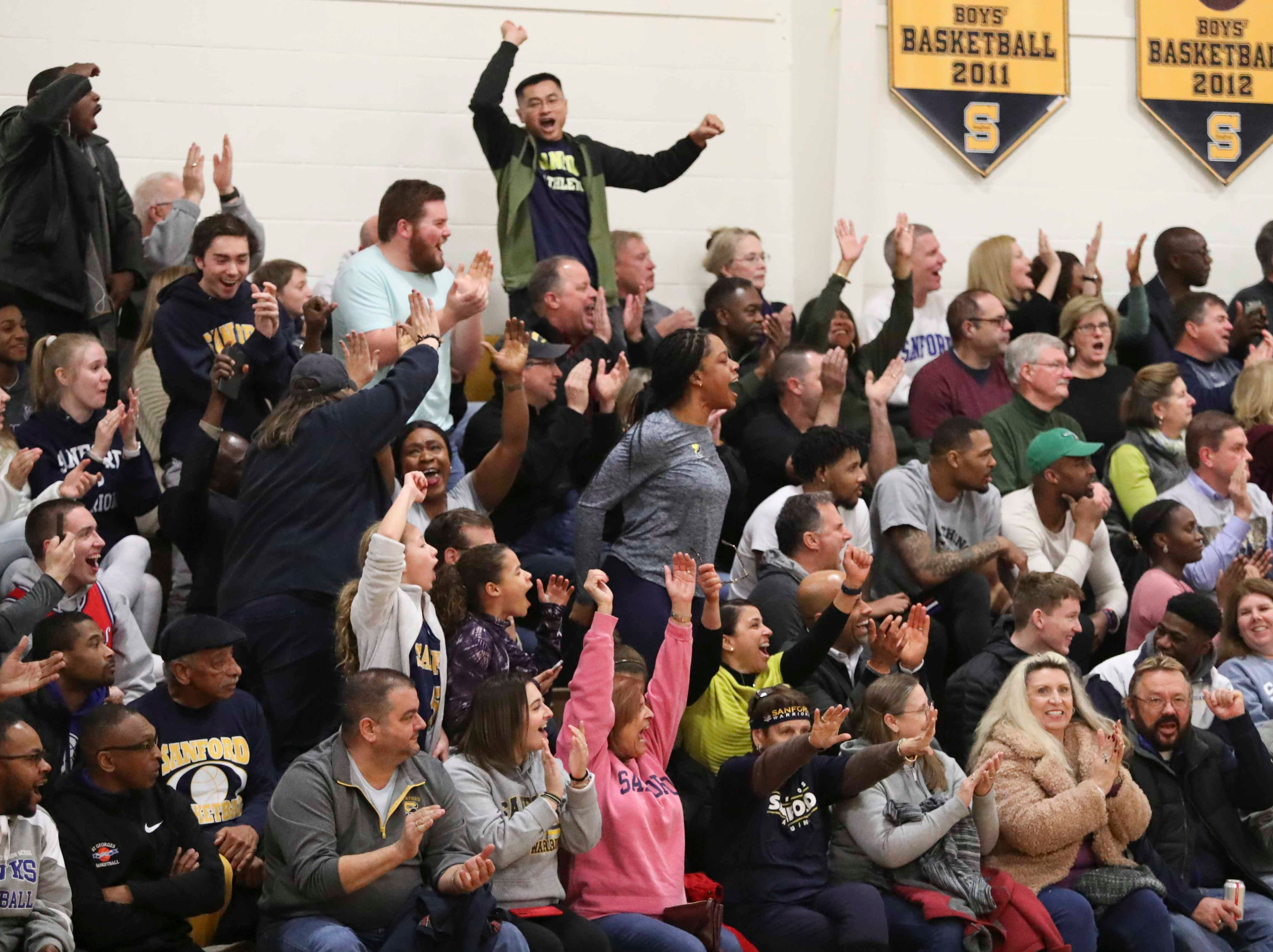 Sanford fans cheer early during the Warriors' 65-47 win at home Friday.