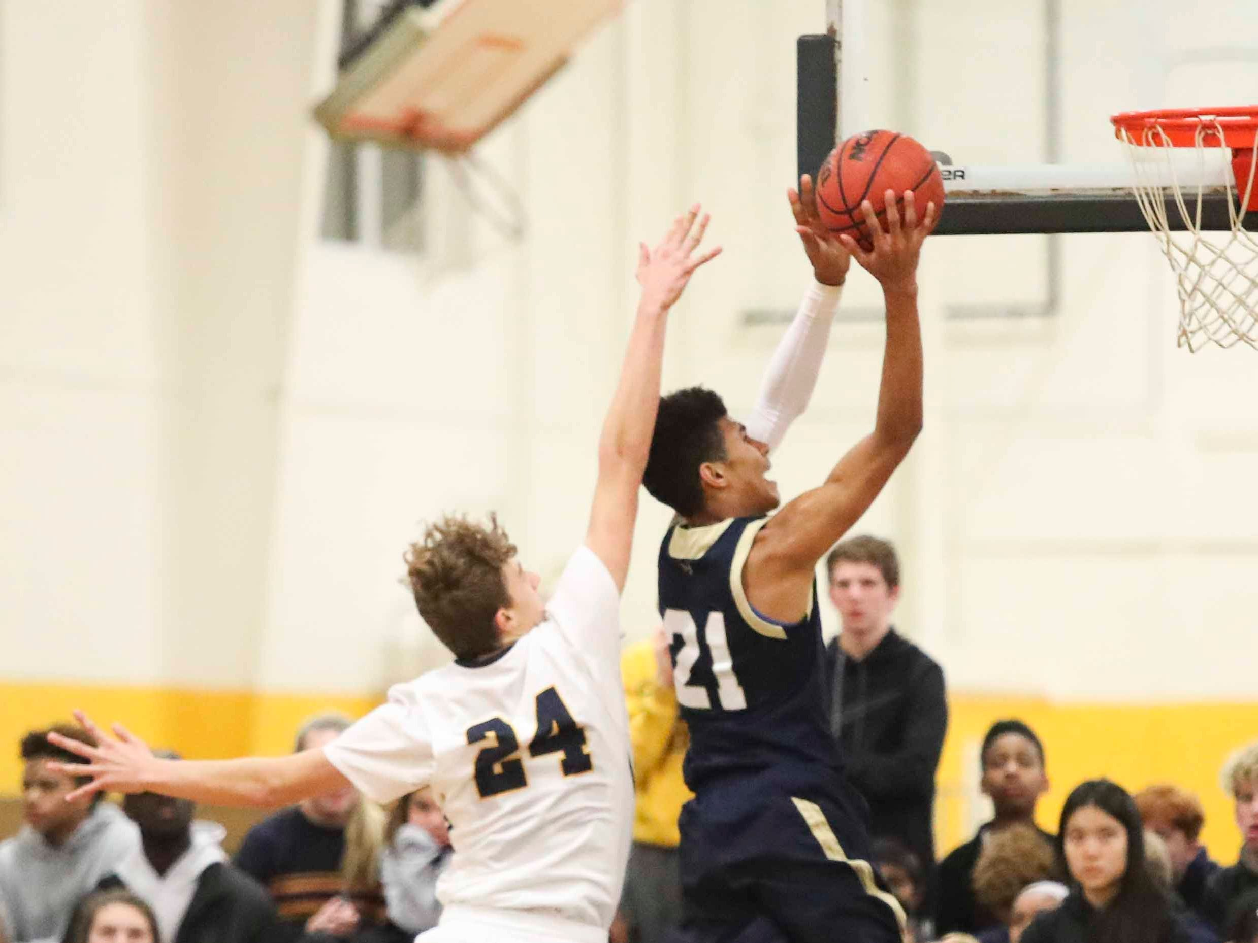 Jax Trickey (24) defends a shot by Salesianum's Ethan Hinds during the Warriors' 65-47 win at home Friday.