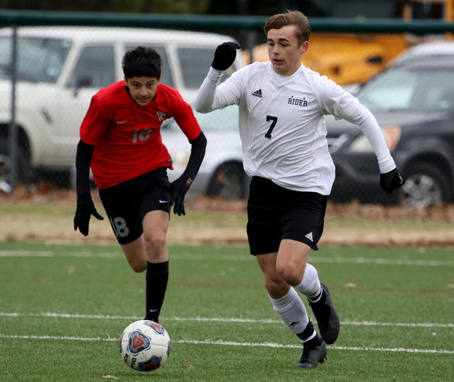 Rider's Hagan Sanchez and Vista Ridge's Anthony Mercado ran after the ball Saturday, Jan. 12, 2019, during the MSU Mustangs Invitational tournament at the Midwestern State University practice soccer field.