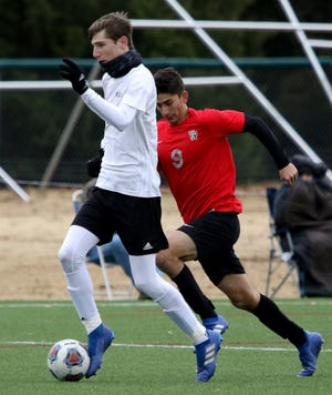 Rider's Rylan Havins dribbles in the game against Vista Ridge Saturday, Jan. 12, 2019, during the MSU Mustangs Invitational tournament at the Midwestern State University practice soccer field.
