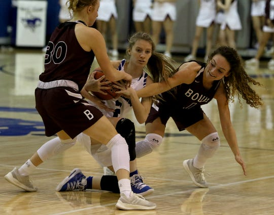 Bowie's Landra Parr, left, Brysen Richey and City View's Mariah Yow fight for the ball Friday, Jan. 11, 2019, in City View.