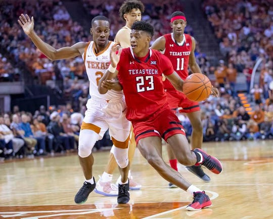 Texas Tech guard Jarrett Culver (23) drives to the basket as Texas guard Matt Coleman III (2) defends during Saturday's second half at Frank Erwin Center.