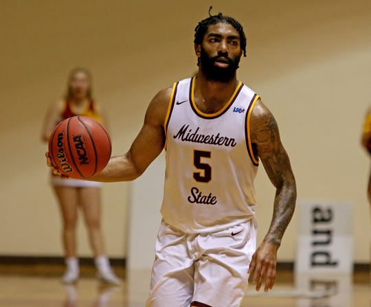 Midwestern State's Josh Wallace dribbles in the game against Western New Mexico Saturday, Jan. 12, 2019, in D.L. Ligon Coliseum. Wallace had 16 points, eight rebounds and seven assists, hitting 7 of 11 shots.