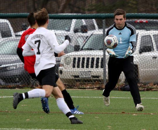 Rider goalkeeper Colby Hincks catches the ball in the game against Vista Ridge Saturday, Jan. 12, 2019, during the MSU Mustangs Invitational tournament at the Midwestern State University practice soccer field.
