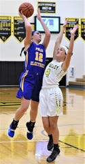 Philo's Joleigh Harrop goes up for a shot against Tri-Valley's Laiken Little in Saturday's game. The Scotties won 64-24.