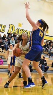 Tri-Valley's Kyndal Howe looks for a shot against Philo's Bethany Colling in Saturday's game.