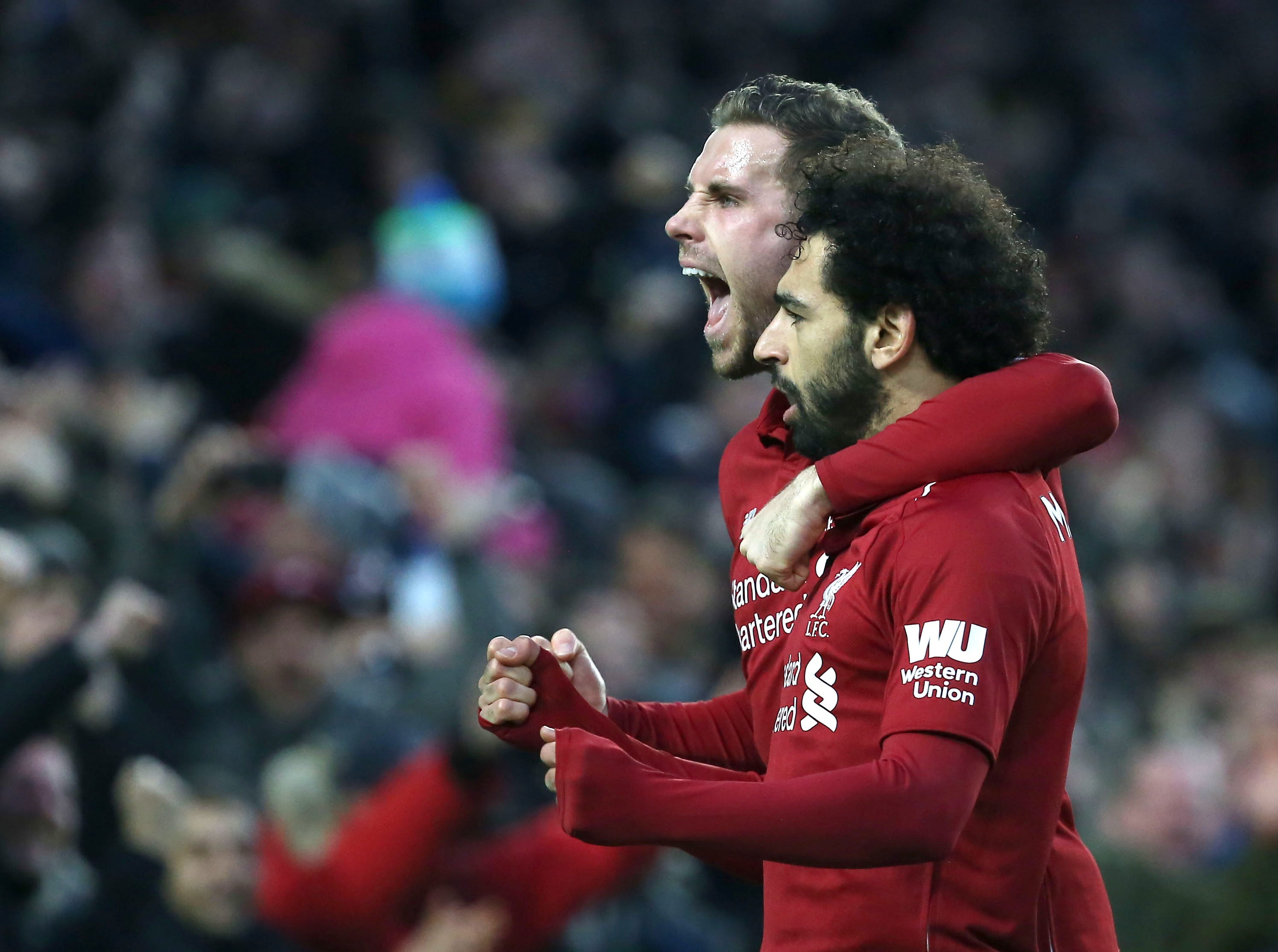 Liverpool's Mohamed Salah celebrates scoring the opening goal against Brighton.