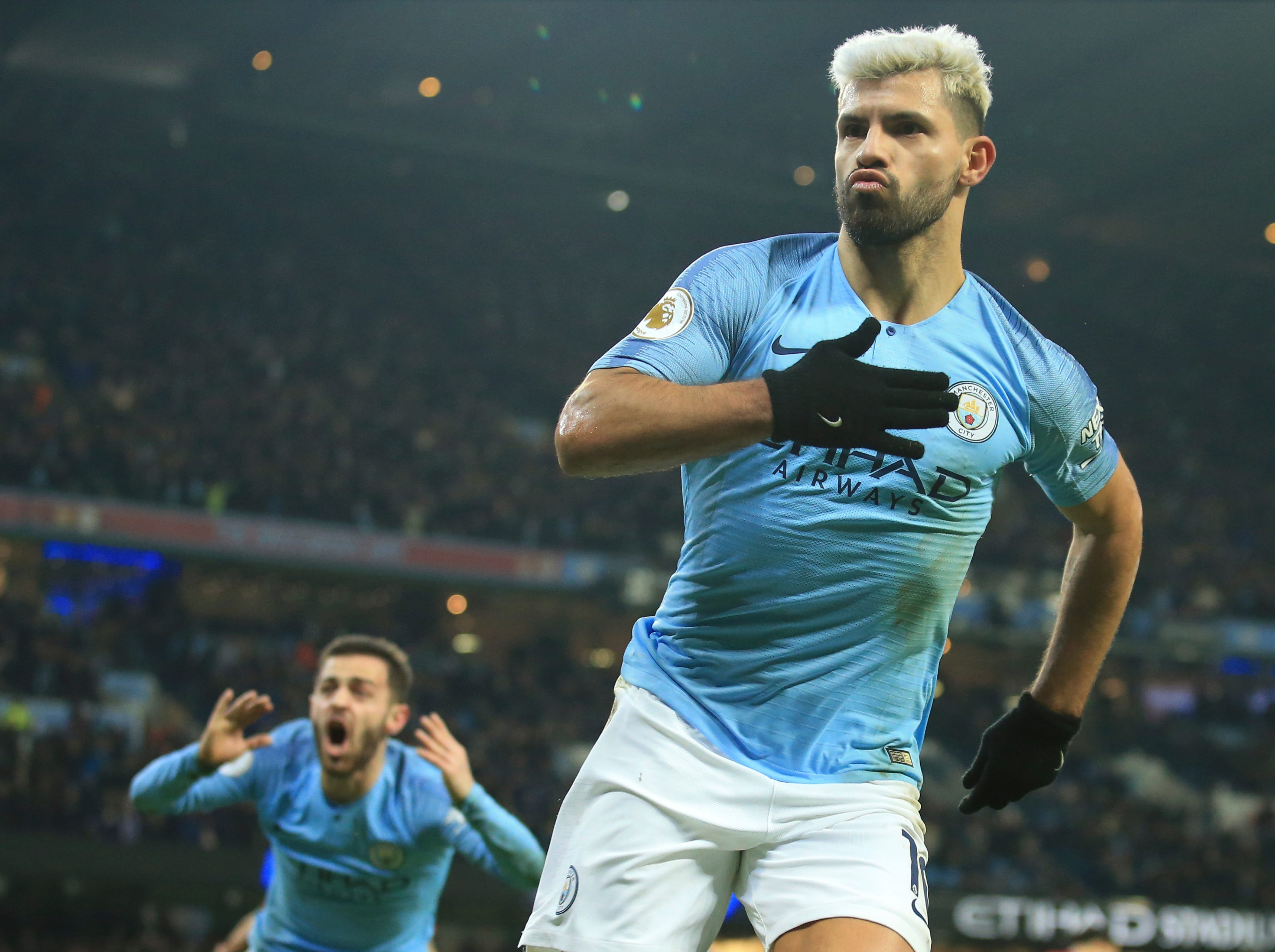 Manchester City's Sergio Aguero celebrates after scoring the opening goal against Liverpool.