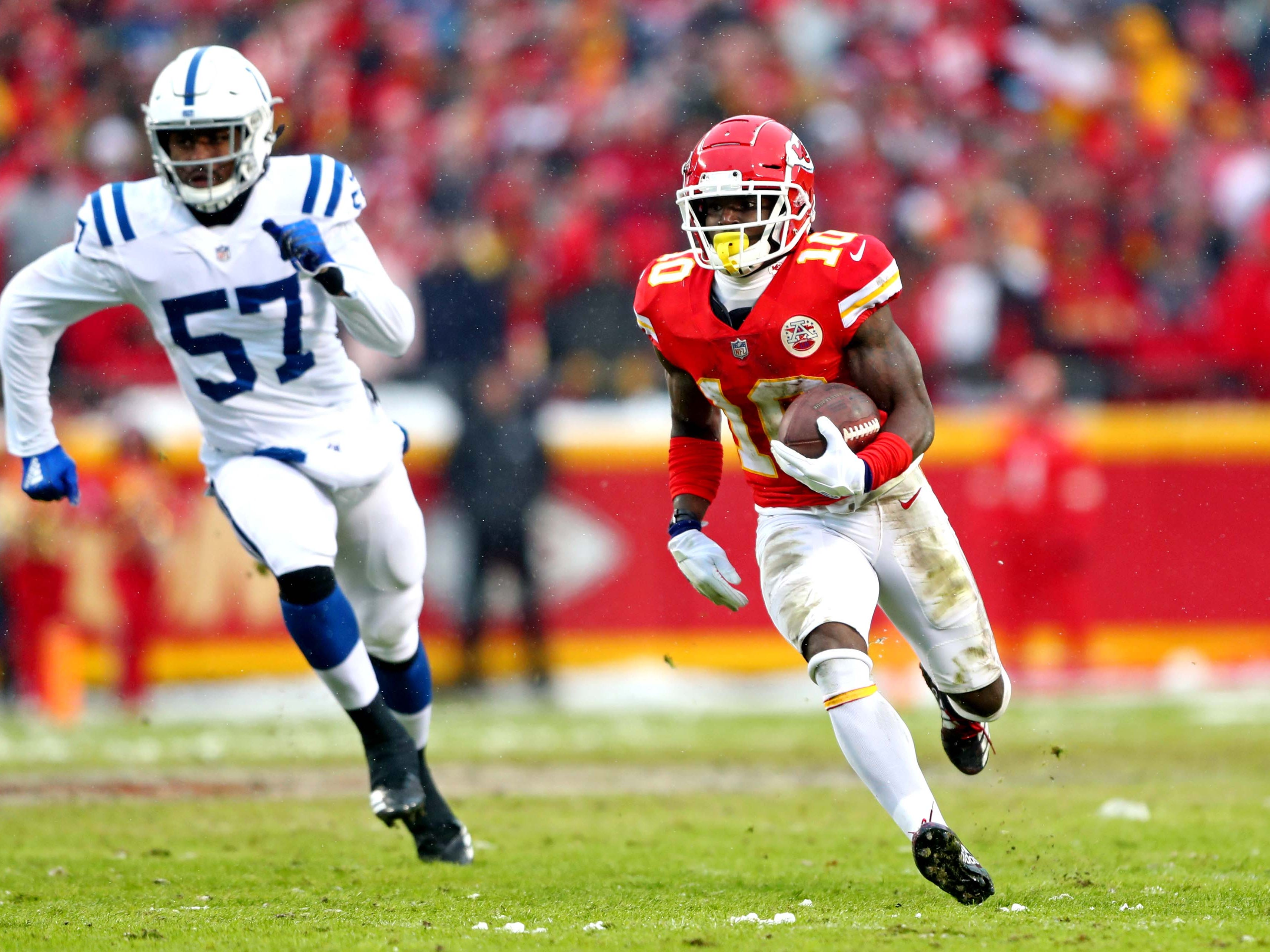 Kansas City Chiefs wide receiver Tyreek Hill (10) runs for a touchdown  during the first quarter against the Indianapolis Colts in an AFC Divisional playoff football game at Arrowhead Stadium.