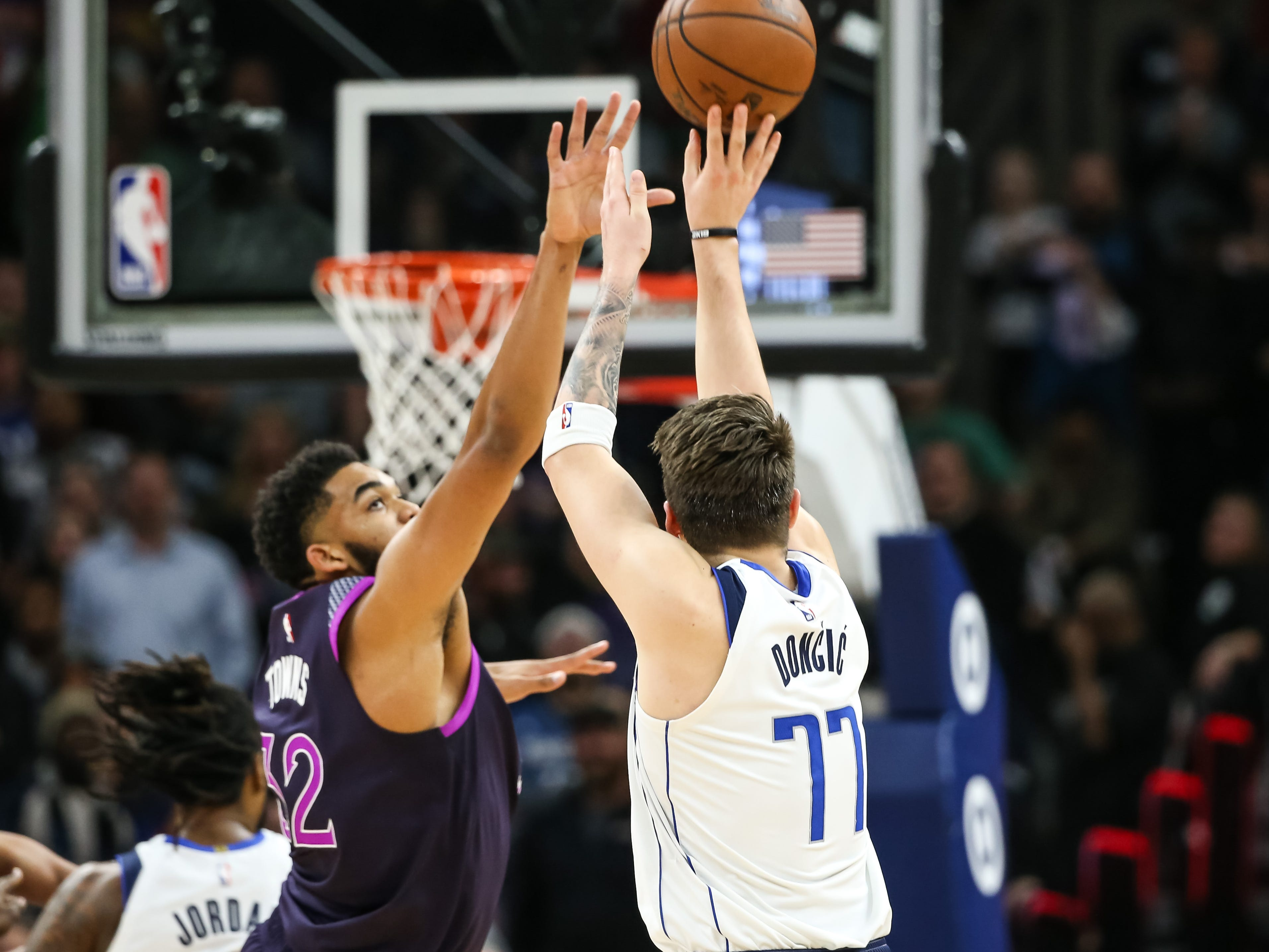 Jan. 11: Mavericks guard Luka Doncic (77) rises and sinks the go-ahead 3-pointer over Timberwolves defender Karl-Anthony Towns (32) in the closing seconds in Minneapolis.