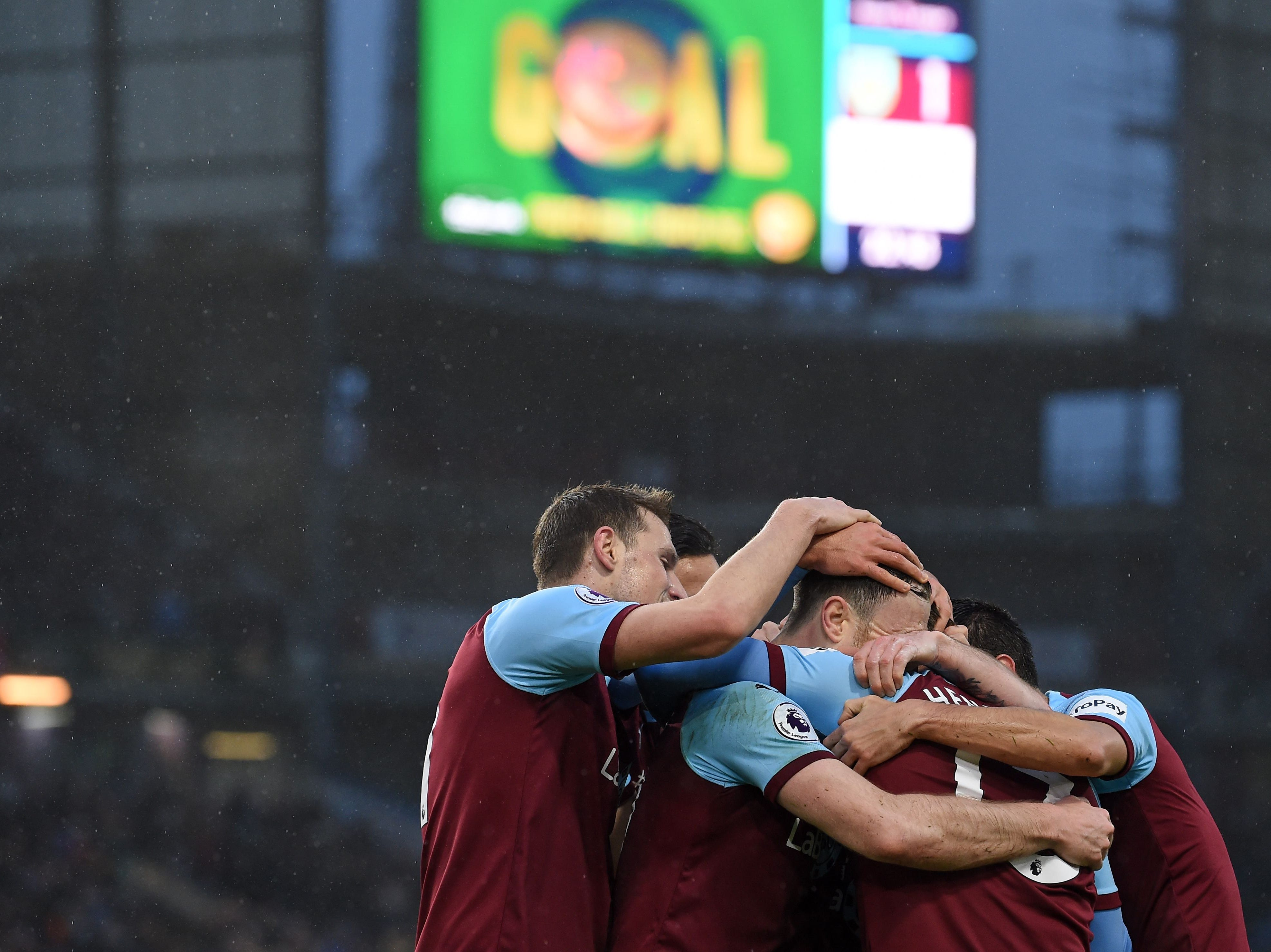Burnley players celebrate after a goal against Fulham.