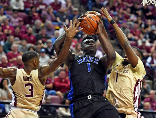 Duke Blue Devils forward Zion Williamson (1) has his shot blocked by Florida State Seminoles forward Raiquan Gray (1) during the first half at Donald L. Tucker Center.