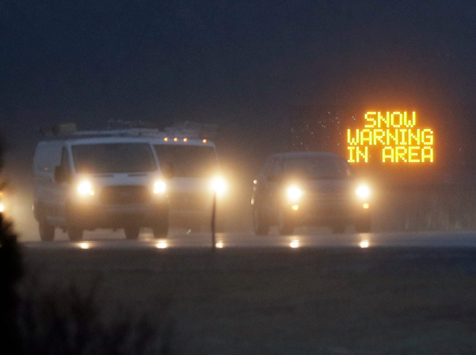 Traffic moves along I-70 near Lawrence, Kan., Friday, Jan. 11, 2019 ahead of an expected snow storm. The area is under a Winter Weather Advisory.