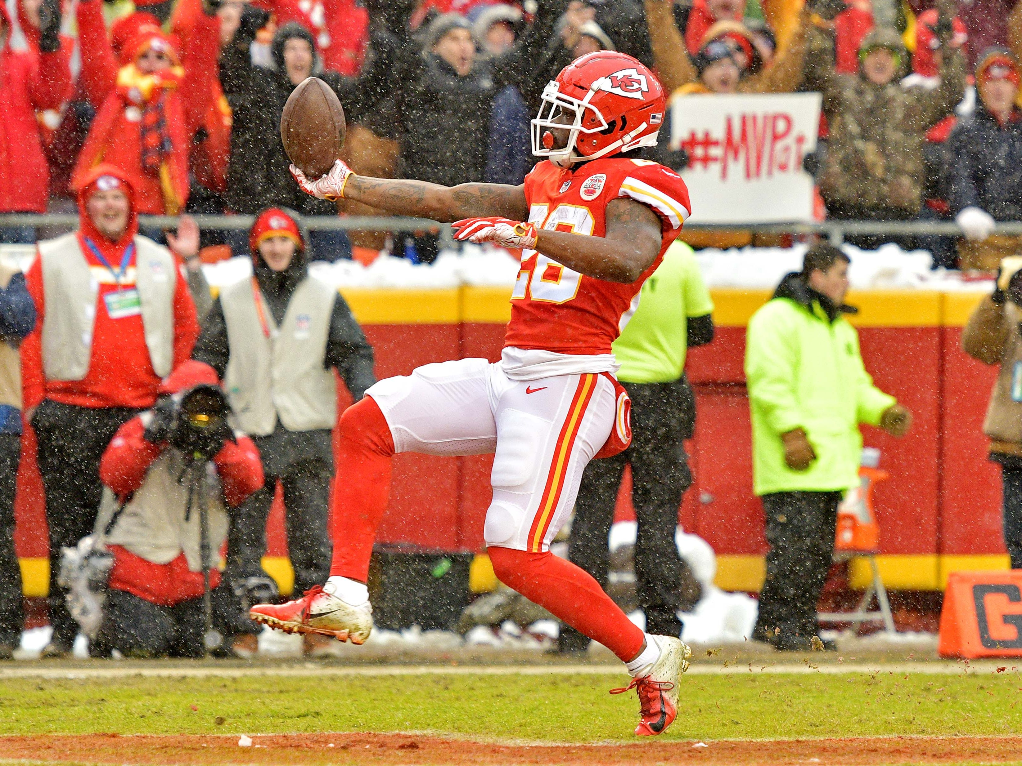 Kansas City Chiefs running back Damien Williams (26) scores a touchdown  during the first quarter against the Indianapolis Colts in an AFC Divisional playoff football game at Arrowhead Stadium.