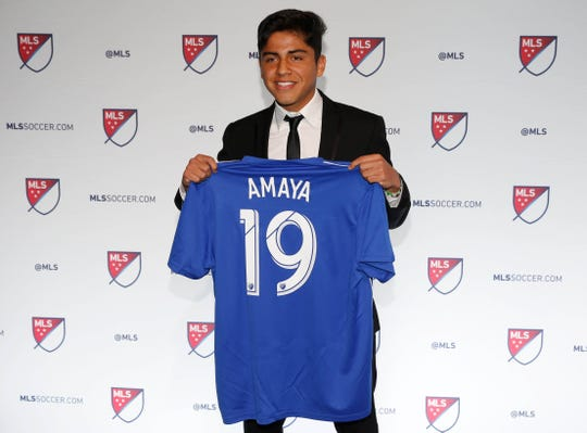 Frankie Amaya holds up his new jersey after being selected as the No. 1 overall pick in the 2019 MLS Super Draft.