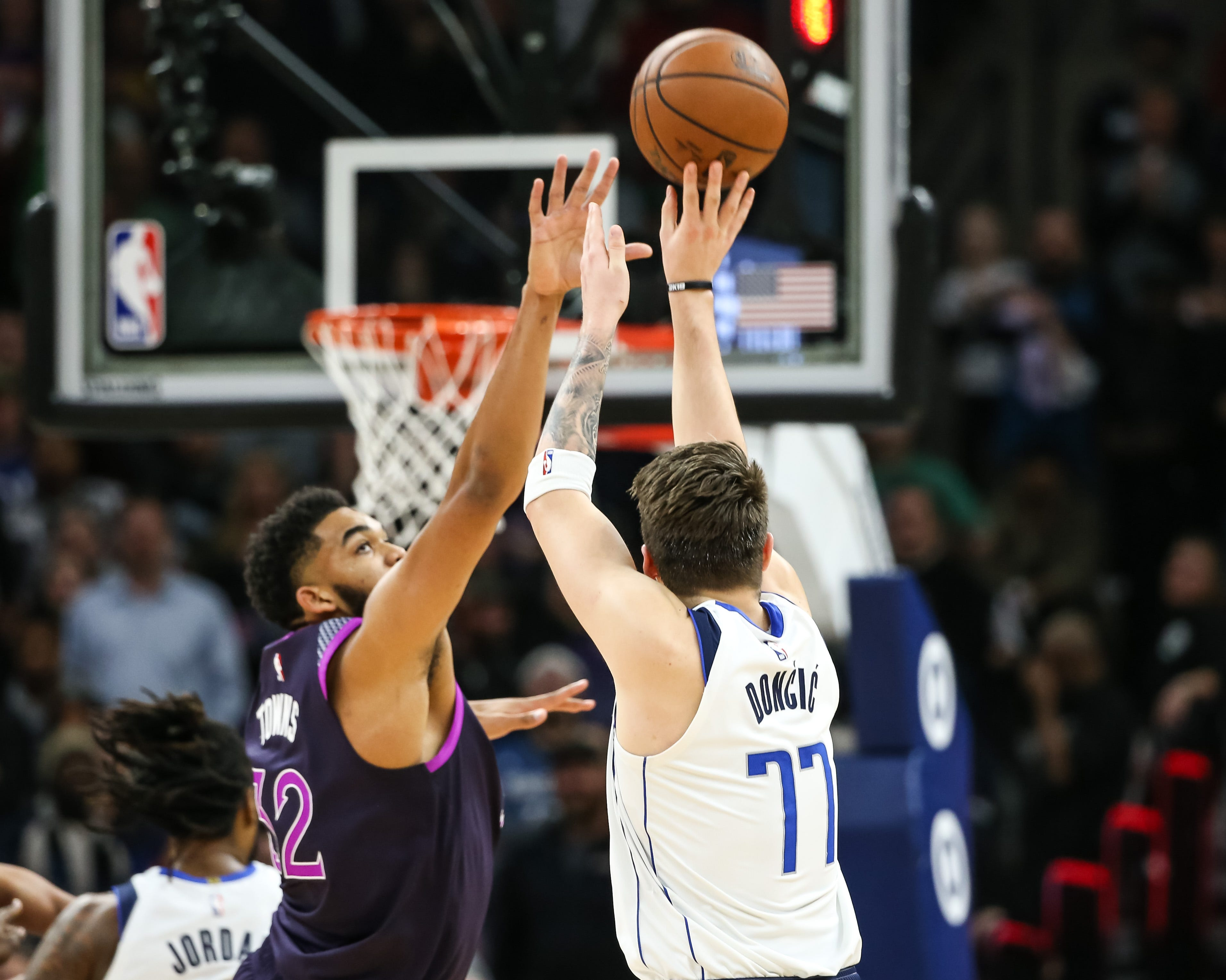 Luka Doncic sinks the go-ahead 3 over Karl-Anthony Towns.