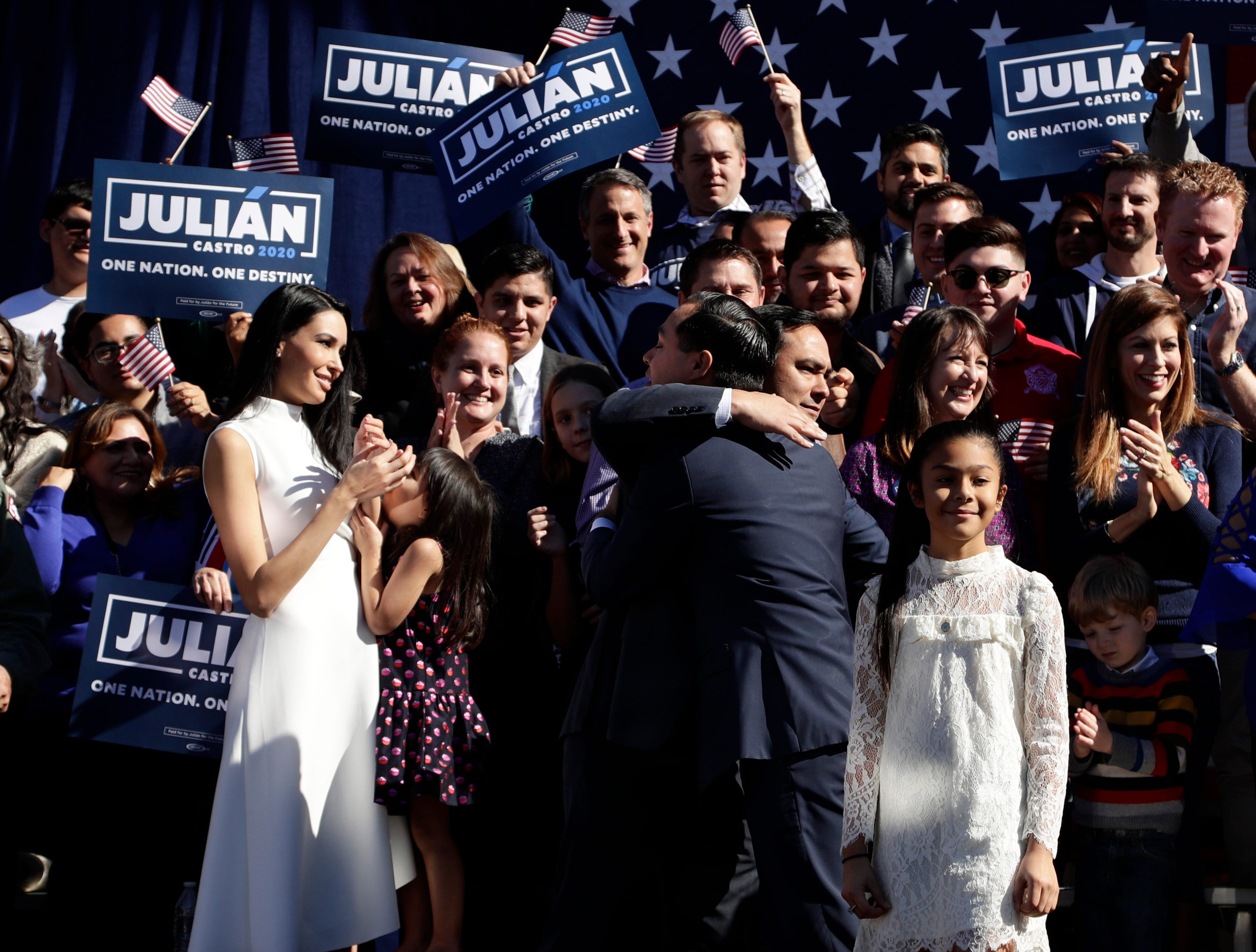Julian Castro, center right, is embraced by his twin brother U.S. Rep. Joaquin Castro (D-San Antonio), center left, during an event where Julian Castro announced his decision to seek the 2020 Democratic presidential nomination.